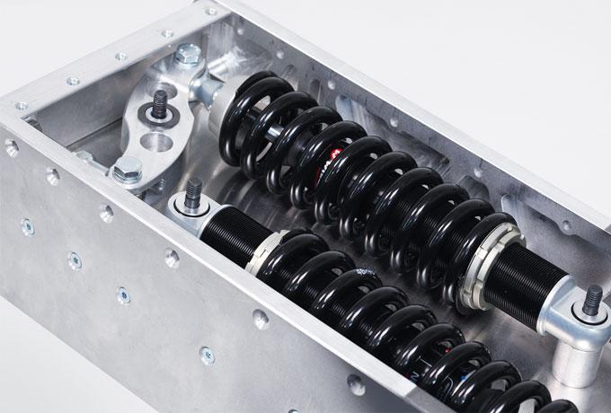 Die Federungseinheit lässt sich neben dem Akku-Pack Platz im extrem  torsionssteife Mittelrahmen aus Aluminium unterbringen.